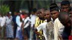 Rohingya migrants in Indonesia wait for breakfast
