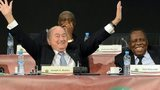 FIFA's president Sepp Blatter (L) gestures as he shares a joke with the public during a general assembly meeting after Cameroonian Issa Hayatou (R) was re-elected unopposed as president of the Confederation of African Football (CAF) on March 10, 2013, in Marrakesh.