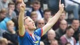 Marley Watkins points to the heavens after scoring