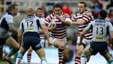 Wigan skipper Sean O'Loughlin runs into a brick wall of Leeds players at Headingley