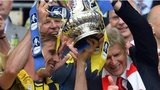 Arsene Wenger and Nacho Monreal celebrate with the FA Cup trophy
