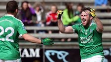 Sean Quigley celebrates scoring the late penalty against Antrim
