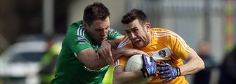 Fermanagh's Richard O'Callaghan battles with Antrim's Conor Murray at Brewster Park