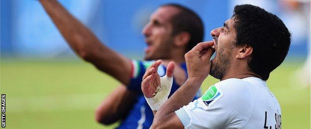 Luis Suarez and Italy defender Giorgio Chiellini