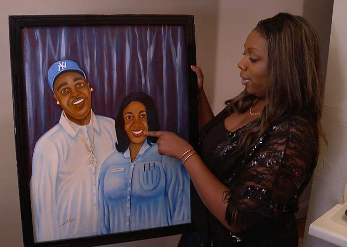 Bree with the painting of her and her father