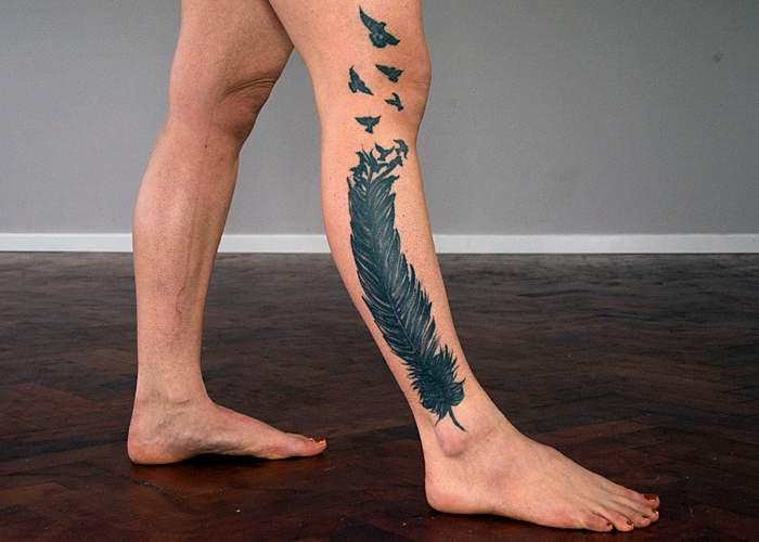 Feather tattoo on Tass's leg