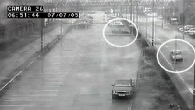 Security camera image with circles indicating two cars.