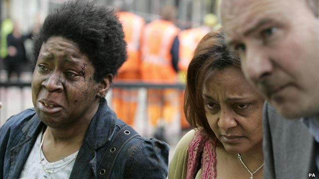 Image of a man and two women, one with signs of facial injury