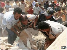 People tried to lift rocks from crushed houses (file pic)