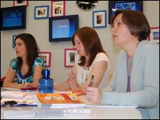 O2 employees, Negin Sabet, Emma Howard and Natalie Warner, sit in a Spanish class