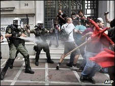 Greek riot policemen clash with protestors in front of the National Bank of Greece (5/5/10)