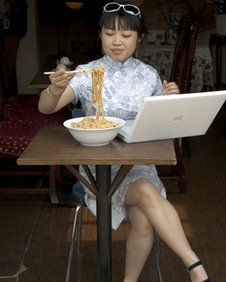 Chinese woman using computer, BBC