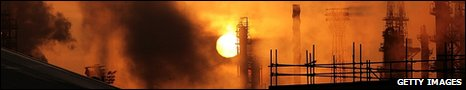 Sunrise over an oil refinery