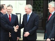 Northern Ireland First Minister Peter Robinson (second left) with Deputy First Minister Martin McGuinness (centre) welcome Scottish First Minister Alex Salmond (left) and the Welsh First Minister Carwyn Jones, to Parliament buildings at Stormont.