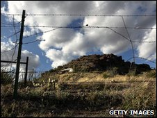 A barbed wire fence along the US-Mexico border at Montezuma Pass, Arizona, file pic from 2 May 2010