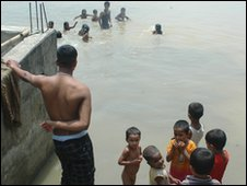 Children play in flooded fields
