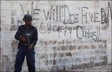 A police officer stands guard blocks away from the Tivoli Gardens neighborhood, Kingston, Jamaica, 26 May, 2010