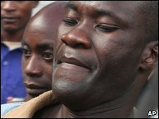 Tiwonge Chimbalanga, right, and Steven Monjeza, middle, are led from court in Blantyre on 20 May 2010