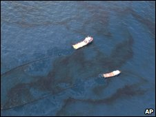 Vessels skim oil in the Gulf of Mexico, 31 May
