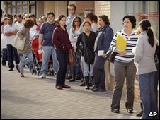 Unemployed line up in Spain