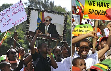 Supporters of Meles Zenawi carry placards criticising rights groups in Addis Ababa on 25 May 25 2010 as they celebrate his poll victory
