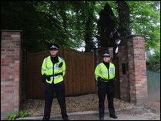 Police guarding Stuart Cable's house in Aberdare
