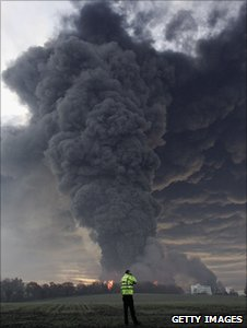 Man looks at cloud coming from Buncefield fire