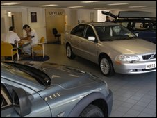 cars in a used car showroom