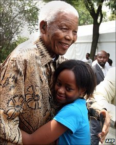 Nelson and Zenani Mandela hug in Soweto, South Africa, file pic  from December 2008