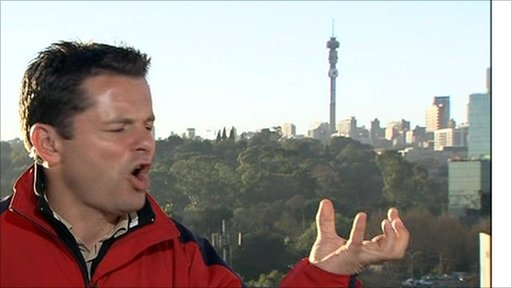 BBC's Chris Hollins hails a cab in S Africa