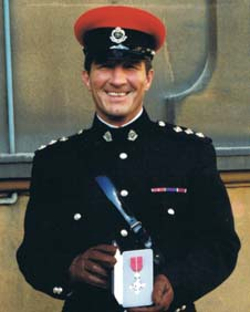 Bill Shaw with his MBE medal
