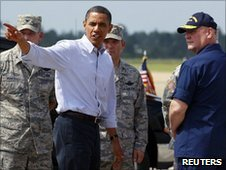 US President Barack Obama walks with National Incident Commander US Coastguard Admiral Thad Allen at Gulfport Airport in Gulfport, Mississippi