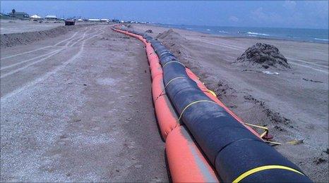 Booms on a beach in Louisiana, US