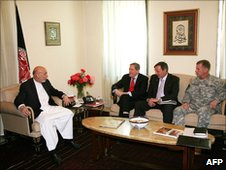 Afghan President Hamid Karzai (L) talks with US Special Representative Richard Holbrooke (2nd L), US Ambassador Karl Eikenberry (2nd R) and US General Stanley McChrystal (L) at the Presidential Palace in Kabul on 22 June2010