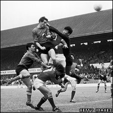 Li Chan Myung, the North Korean goalkeeper clears the ball from Fogli and Perani, Middlesbrough, 1966