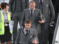 England team arrive home