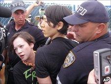Takeru Kobayashi (c) is lead away by police