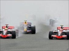 McLaren drivers Lewis Hamilton and Heikki Kovalainen vie for the lead of the 2008 British Grand Prix at Silverstone