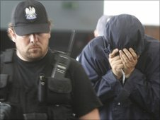 Uri Brodsky (right) was brought to court under heavy security 5 July 2010