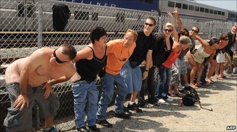 Residents of Laguna Niguel expose their buttocks to a passing Amtrak train