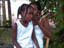 Telia Jacques, 6, with her mother Bruna, Anse-a-Veau, Haiti.