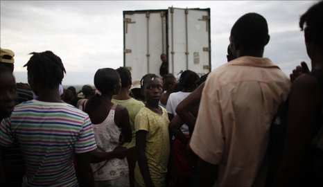 People wait in line for tents at the Canahan 2 camp for earthquake displaced people on the outskirts of Port-au-Prince, Haiti, June 30, 2010,