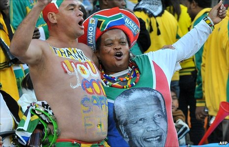 South Africa supporters celebrate after midfielder teammate Siphiwe Tshabalala scored the opening goal against Mexico