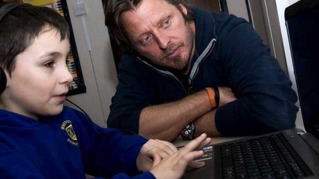 Charley Boorman and a pupil try out a programme designed for children with dyslexia