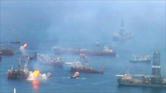 Flotilla of ships above the oil leak