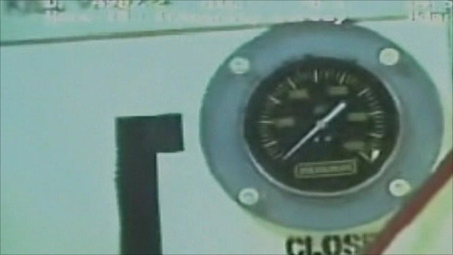 A pressure gauge on the oil well cap