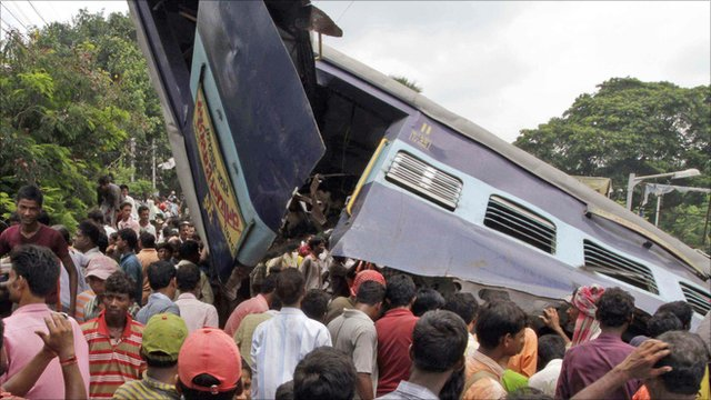 People at the wreckage of the train carriage