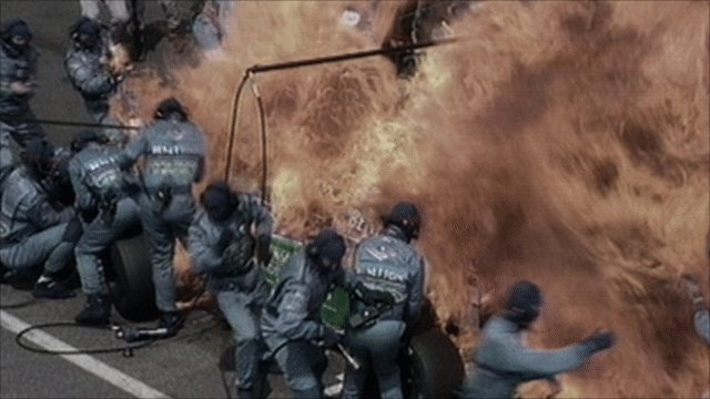 Jos Verstappen's Benetton catches fire during a pit stop