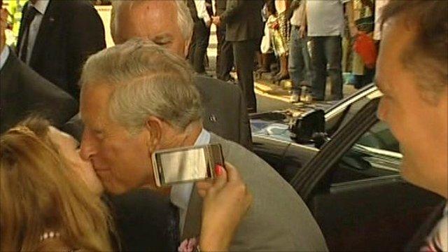 Prince Charles kissing lady on cheek