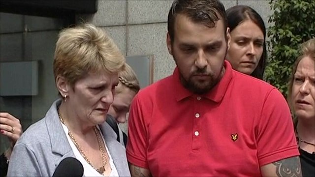 Ian Tomlinson's widow, Julia, and son Paul King